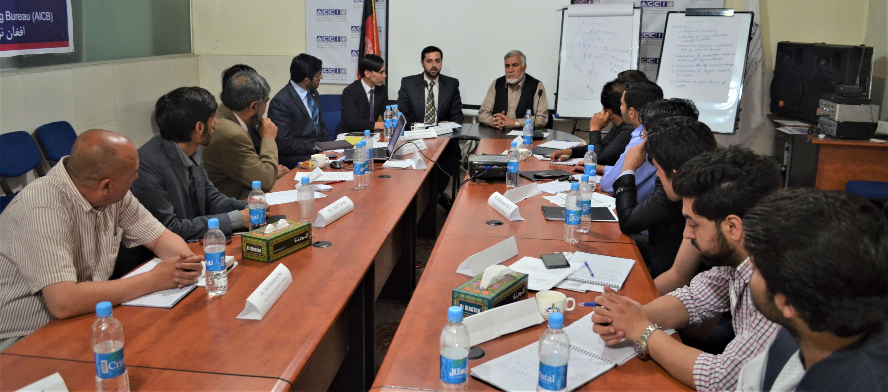 A meeting room full of people, Khan alokozay, project implementation, advisors, consultants, aicb, afghan innovative consulting bureau, consultancy, advisor, consultant, consultancy in Afghanistan, best consultancy