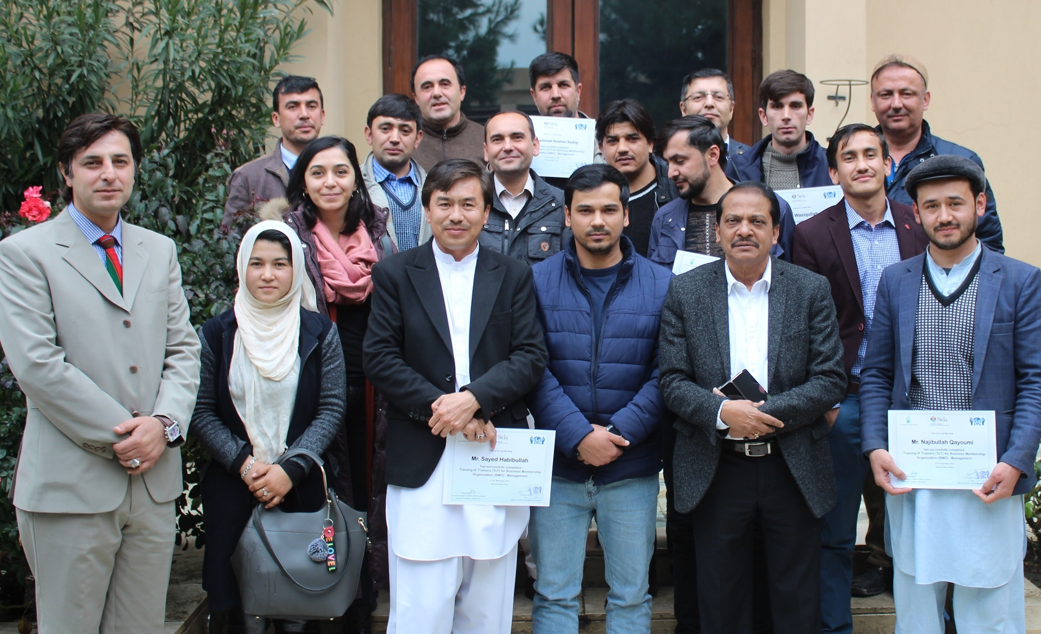 A project has been completed and people are standing holding their certificates, aicb, afghan innovative consulting bureau, consultancy, advisor, consultant, consultancy in Afghanistan, best consultancy
